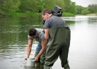 Filming presenter Rav Wilding looking for river mussels (The One Show - BBC)